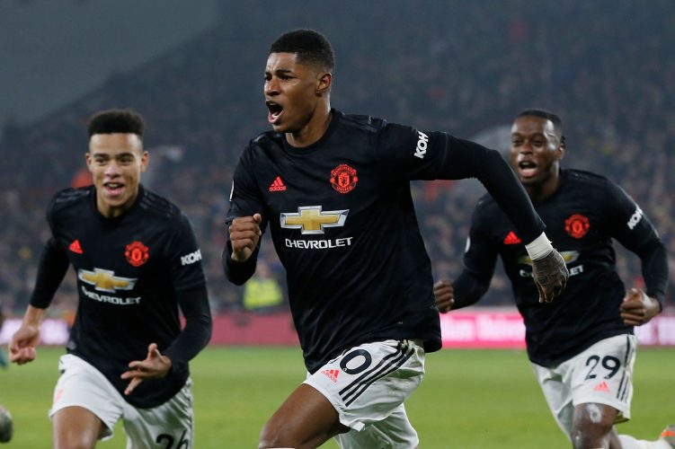 Manchester United's Marcus Rashford celebrates scoring their third goal.