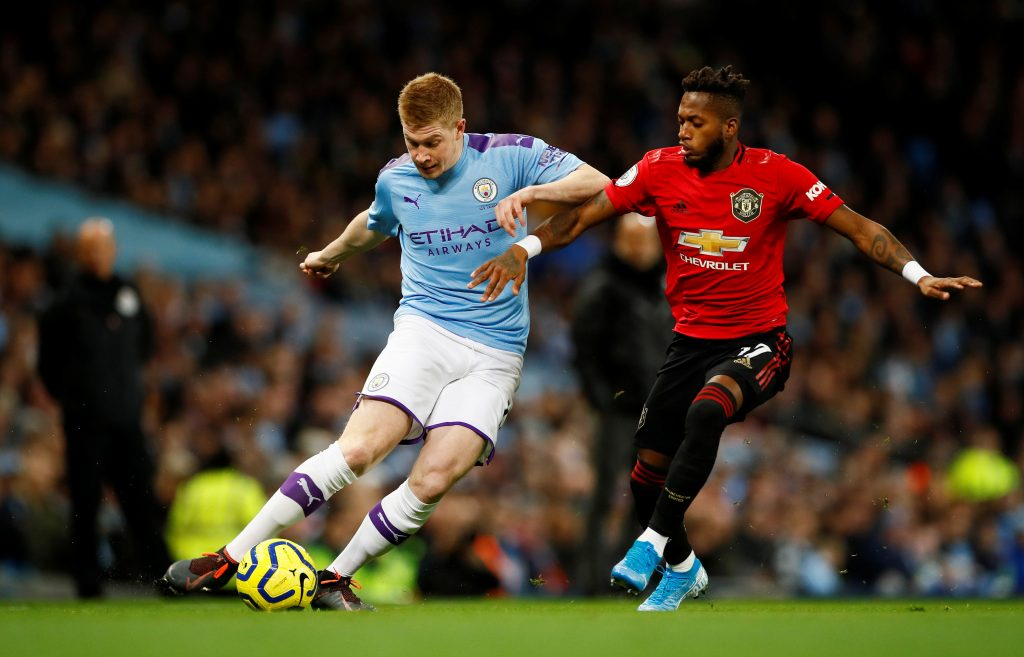 Man City's Kevin De Bruyne in action with Man Utd's Fred.