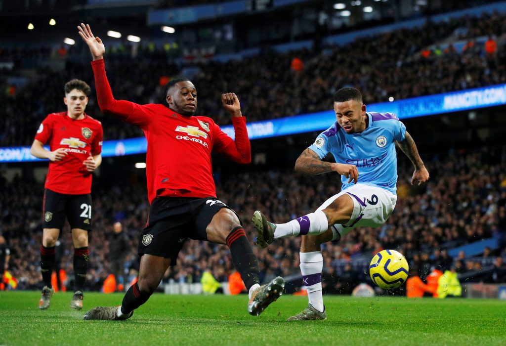 Man City's Gabriel Jesus in action with Man Utd's Aaron Wan-Bissaka.