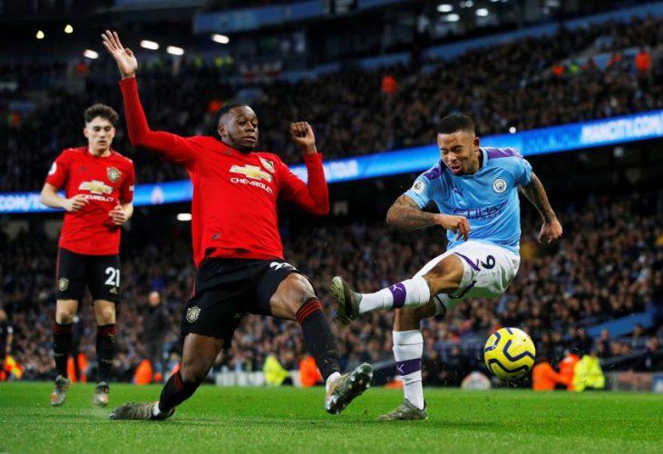 Man City's Gabriel Jesus in action with Man Utd's Aaron Wan-Bissaka.