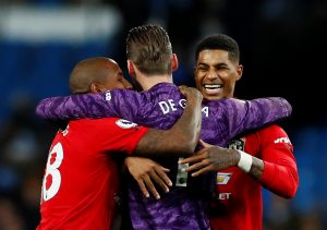Marcus Rashford, Ashley Young and David de Gea celebrate after the match.