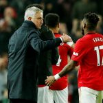 Tottenham Hotspur manager Jose Mourinho shakes hands with Manchester United's Fred after the match.