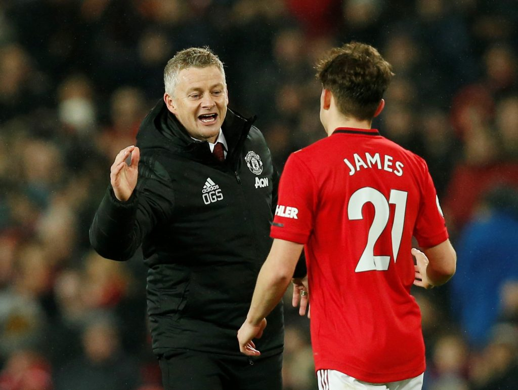 Manchester United manager Ole Gunnar Solskjaer celebrates with Daniel James.