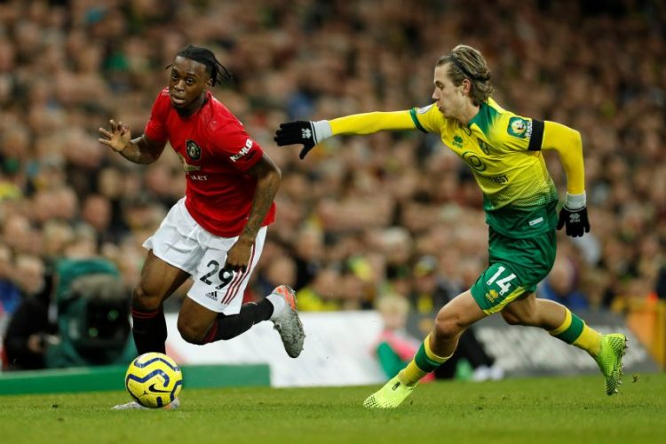 Manchester United's Aaron Wan-Bissaka in action with Norwich City's Todd Cantwell.