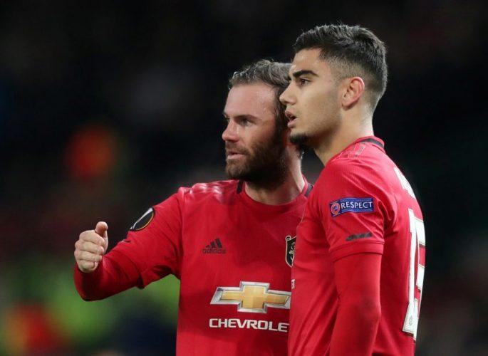 Manchester United's Juan Mata and Andreas Pereira.