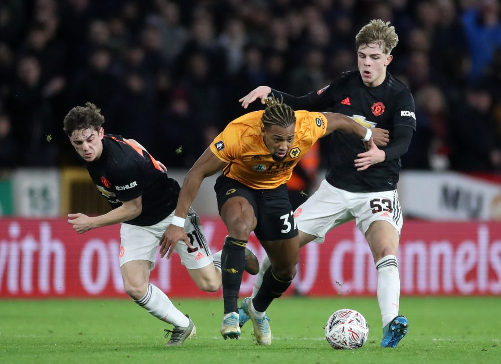 Brandon Williams and Daniel James in action with Wolverhampton Wanderers' Adama Traore.