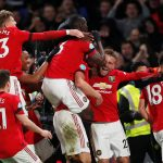 Manchester United's Harry Maguire celebrates scoring their second goal with Luke Shaw, Bruno Fernandes and teammates.