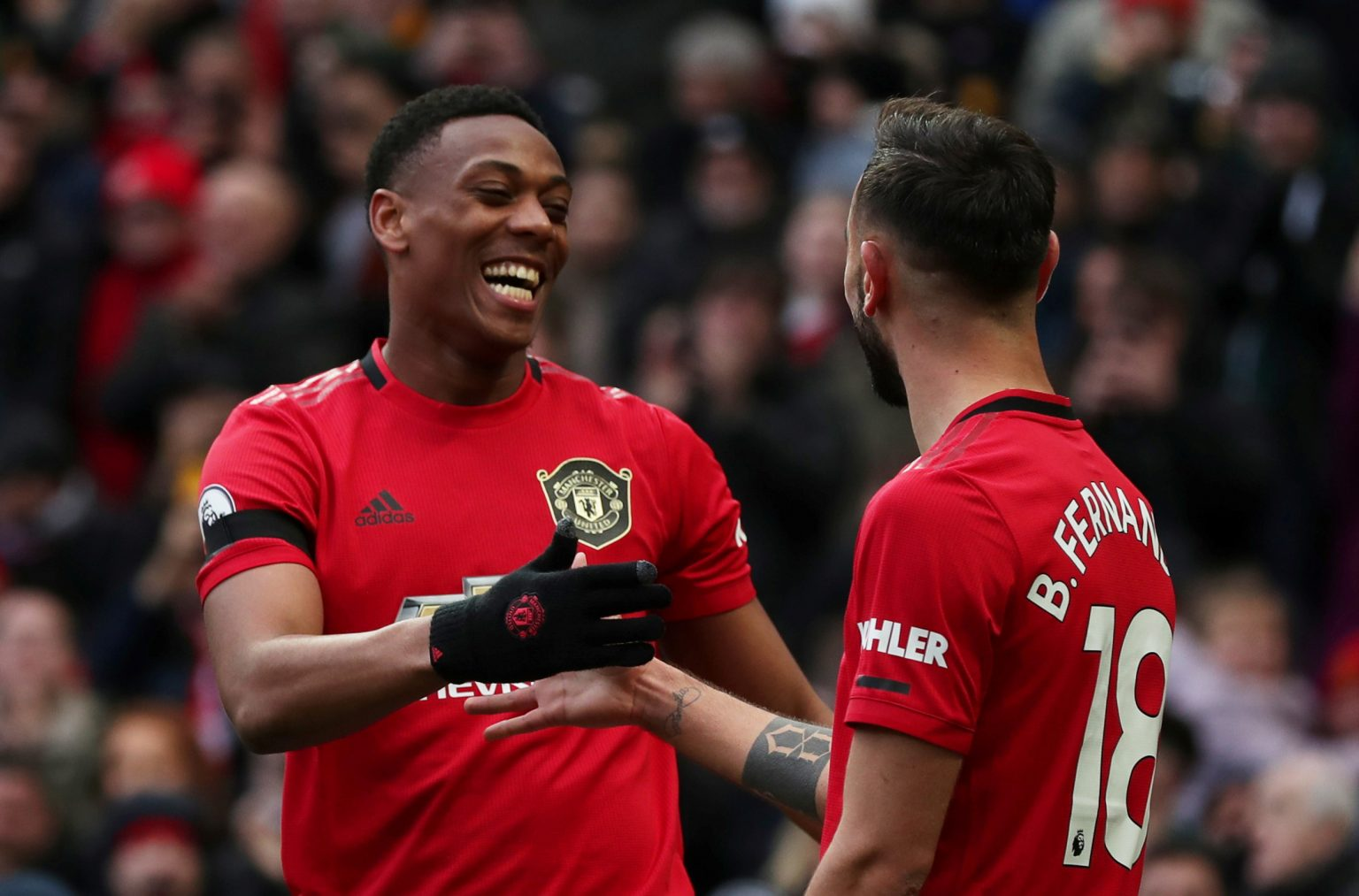 Man Utd's Anthony Martial celebrates scoring their second goal with Bruno Fernandes.