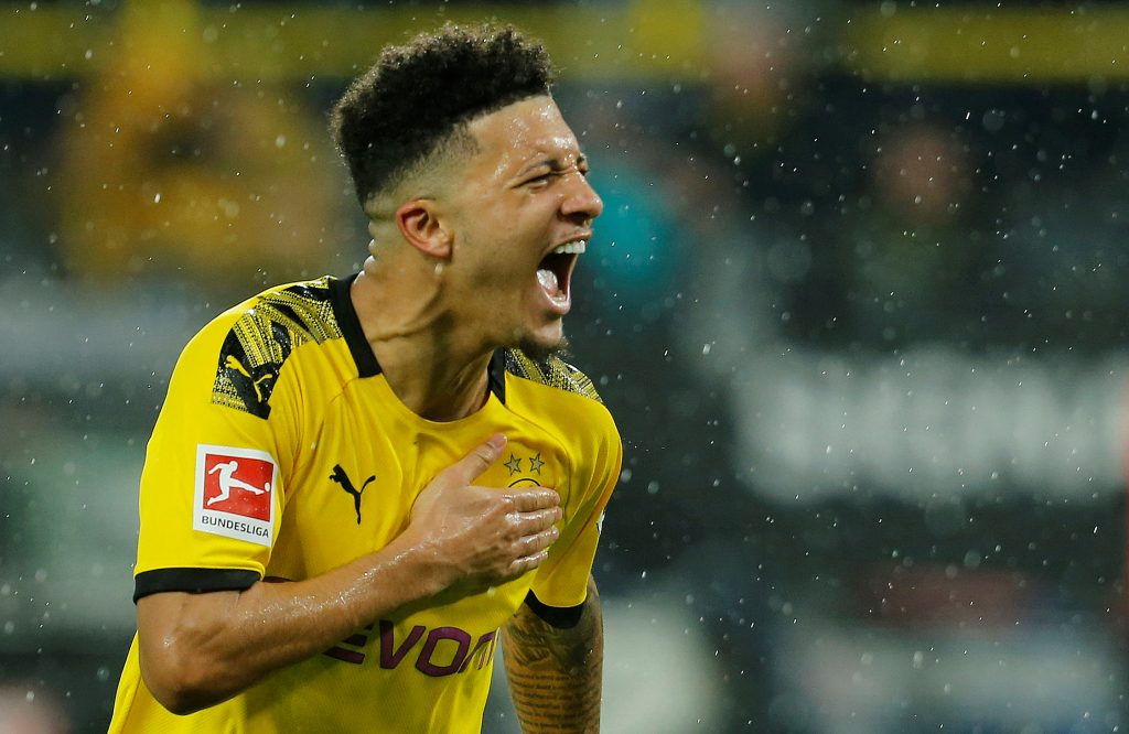 Soccer Football - Bundesliga - Borussia Dortmund v RB Leipzig - Signal Iduna Park, Dortmund, Germany - December 17, 2019  Borussia Dortmund's Jadon Sancho celebrates scoring their third goal   REUTERS/Leon Kuegeler  DFL regulations prohibit any use of photographs as image sequences and/or quasi-video     TPX IMAGES OF THE DAY - RC28XD918HHQ