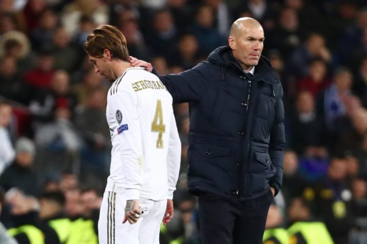 Real Madrid's Sergio Ramos looks dejected as he walks past coach Zinedine Zidane.