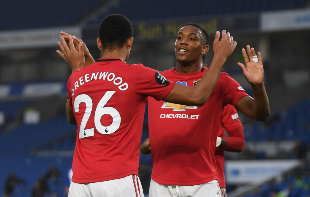 Manchester United's Mason Greenwood celebrates scoring their first goal with Anthony Martial.
