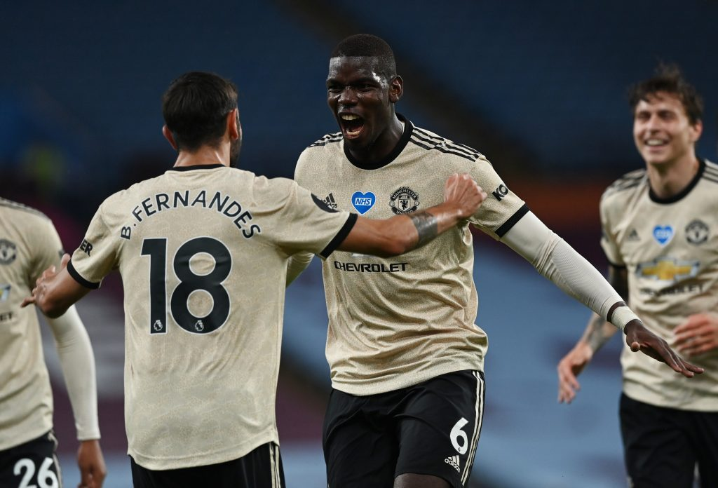 Manchester United's Paul Pogba celebrates scoring their third goal with Bruno Fernandes.