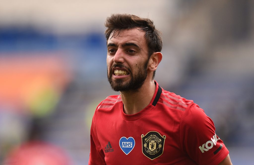 Soccer Football - Premier League - Leicester City v Manchester United - King Power Stadium, Leicester, Britain - July 26, 2020  Manchester United's Bruno Fernandes reacts, as play resumes behind closed doors following the outbreak of the coronavirus disease (COVID-19) Pool via REUTERS/Oli Scarff EDITORIAL USE ONLY. No use with unauthorized audio, video, data, fixture lists, club/league logos or 'live' services. Online in-match use limited to 75 images, no video emulation. No use in betting, games or single club/league/player publications.  Please contact your account representative for further details. - UP1EG7Q17JFNX