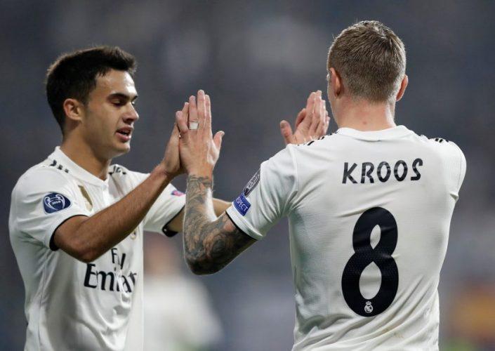 Real Madrid's Toni Kroos celebrates with Sergio Reguilon.