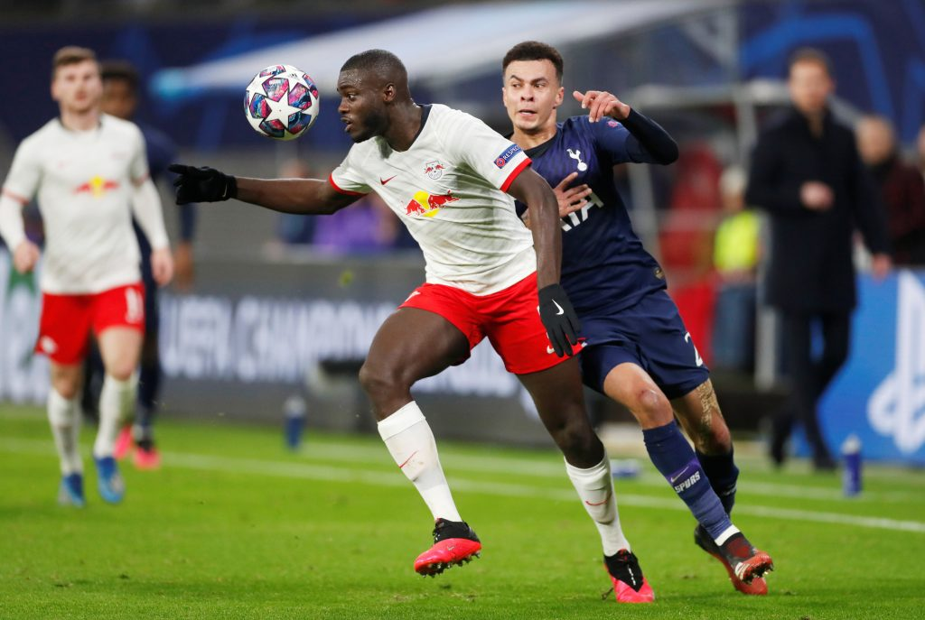 RB Leipzig's Dayot Upamecano in action with Tottenham Hotspur's Dele Alli.