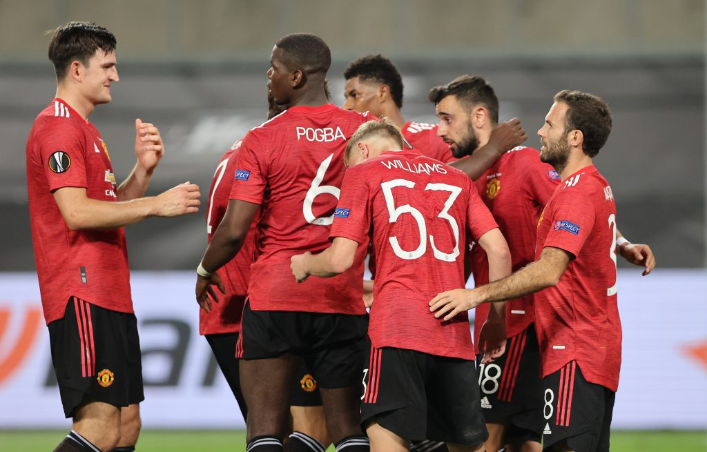 Manchester United's Bruno Fernandes celebrates scoring their first goal with teammates.