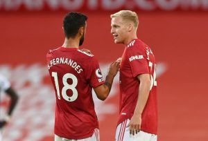Manchester United's Donny van de Beek celebrates scoring their first goal with Bruno Fernandes.