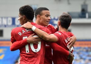 Marcus Rashford celebrates scoring Man Utd's second goal with Bruno Fernandes and Mason Greenwood.