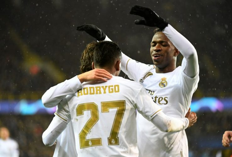 Real Madrid's Rodrygo celebrates scoring their first goal with Vinicius Junior.