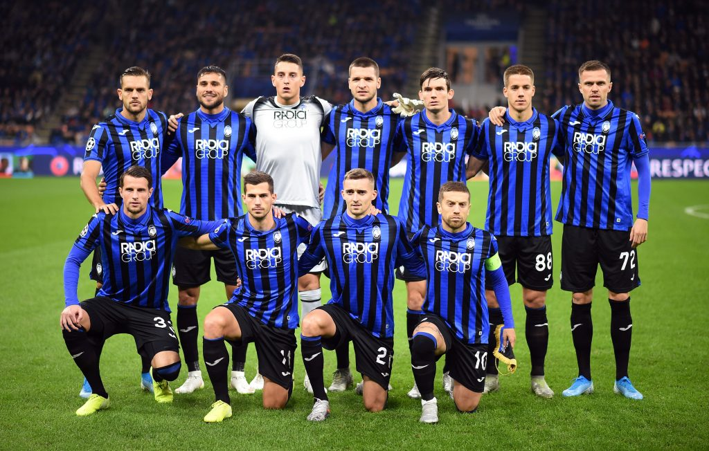 Atalanta players pose for a team group photo before the match.