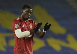 Manchester United's Paul Pogba celebrates scoring their third goal.