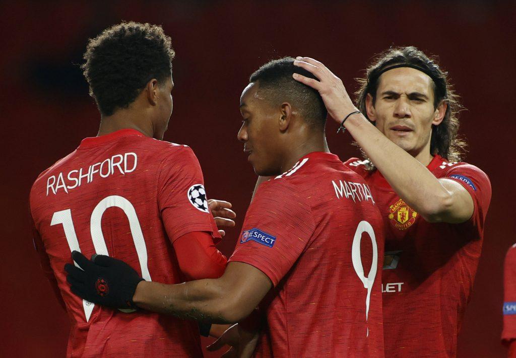 Man Utd forward Anthony Martial celebrates with Marcus Rashford and Edinson Cavani.