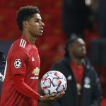 Manchester United's Marcus Rashford celebrates with the match ball.