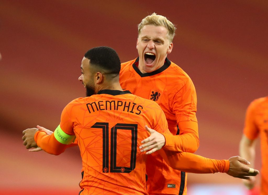 Netherlands' Donny van de Beek celebrates scoring their first goal with Memphis Depay.