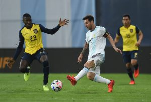 Argentina's Lionel Messi in action with Ecuador's Moises Caicedo.