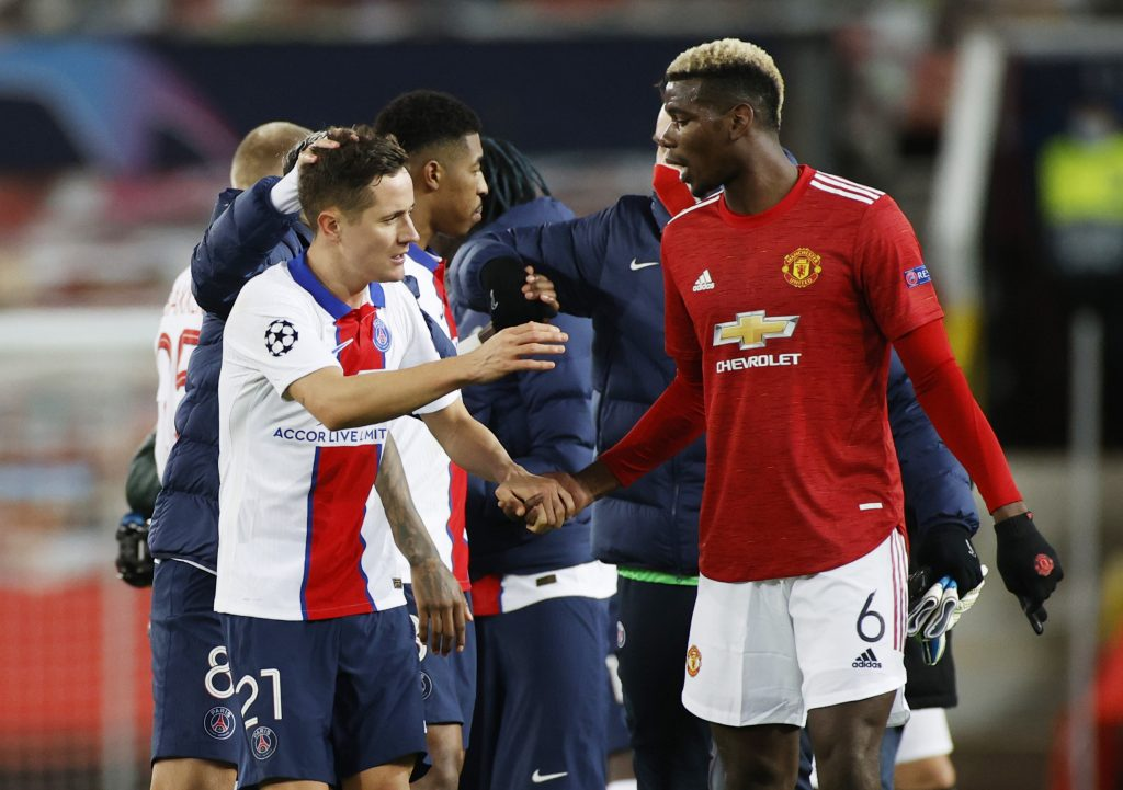 Man Utd's Paul Pogba and PSG's Ander Herrera after the match.