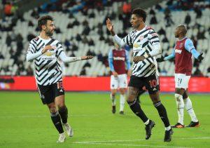 Manchester United's Marcus Rashford celebrates scoring their third goal with Bruno Fernandes.
