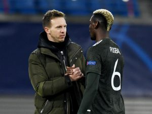 RB Leipzig coach Julian Nagelsmann shakes hands with Man Utd's Paul Pogba after the match.