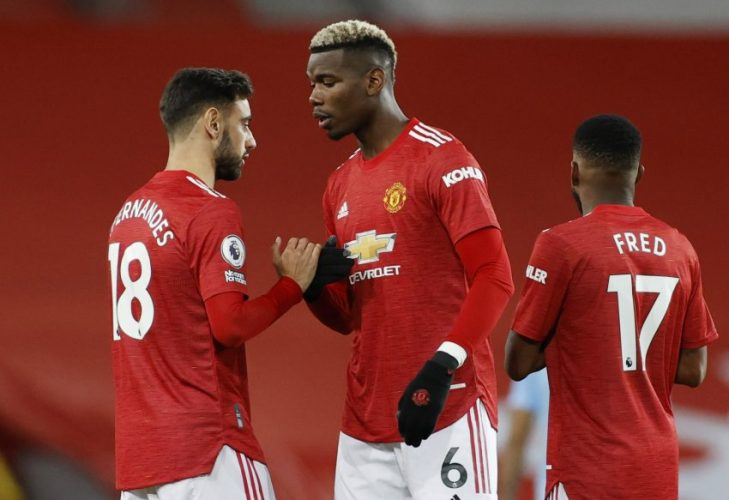 Manchester United's Paul Pogba shakes hands with Bruno Fernandes before the match.