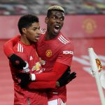 Manchester United's Marcus Rashford celebrates scoring their first goal with Paul Pogba.