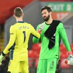 Manchester United's David de Gea and Liverpool's Alisson after the match.