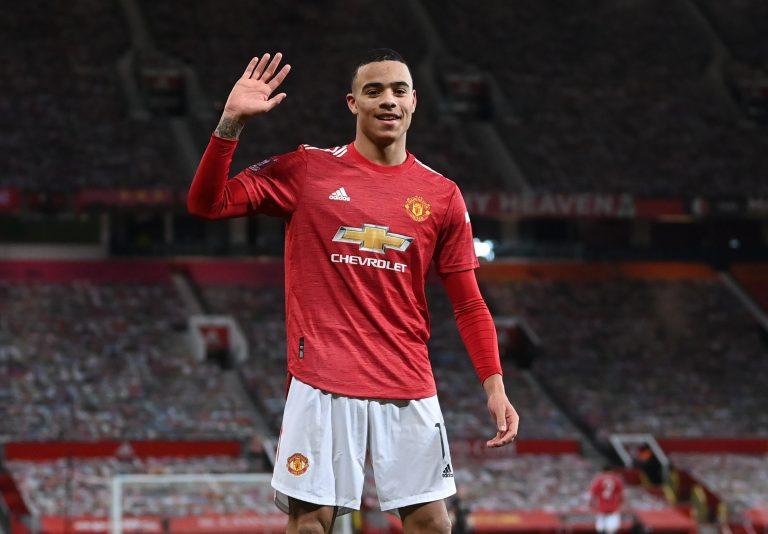 Manchester United's Mason Greenwood celebrates scoring their first goal.
