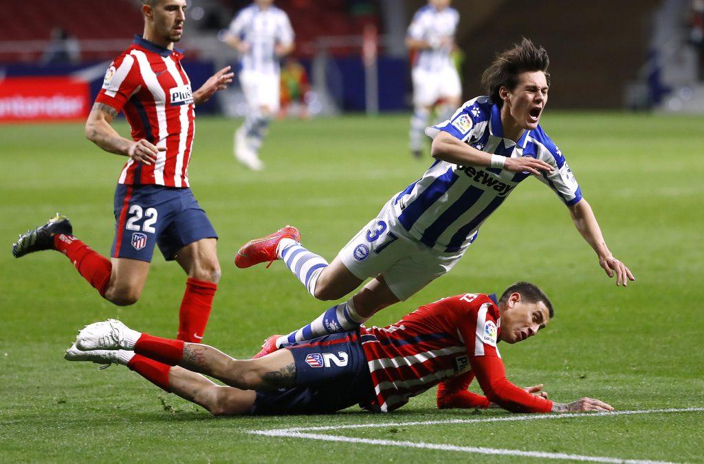 Deportivo Alaves' Facundo Pellistri in action with Atletico Madrid's Jose Gimenez.