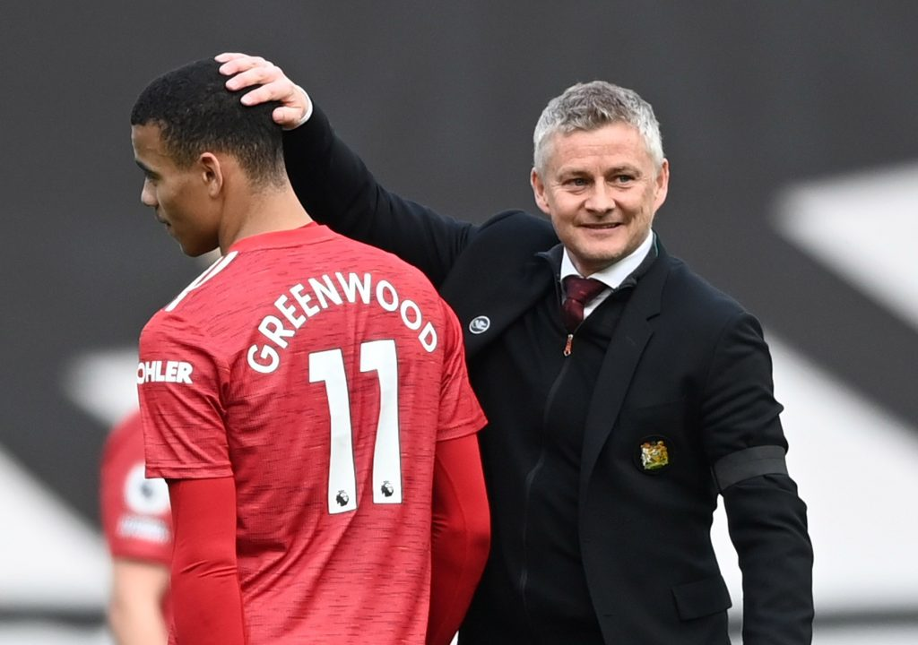 Manchester United manager Ole Gunnar Solskjaer with Mason Greenwood after the match.