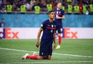 France's Raphael Varane reacts.