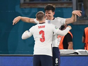 England's Harry Maguire celebrates scoring their second goal with Luke Shaw.