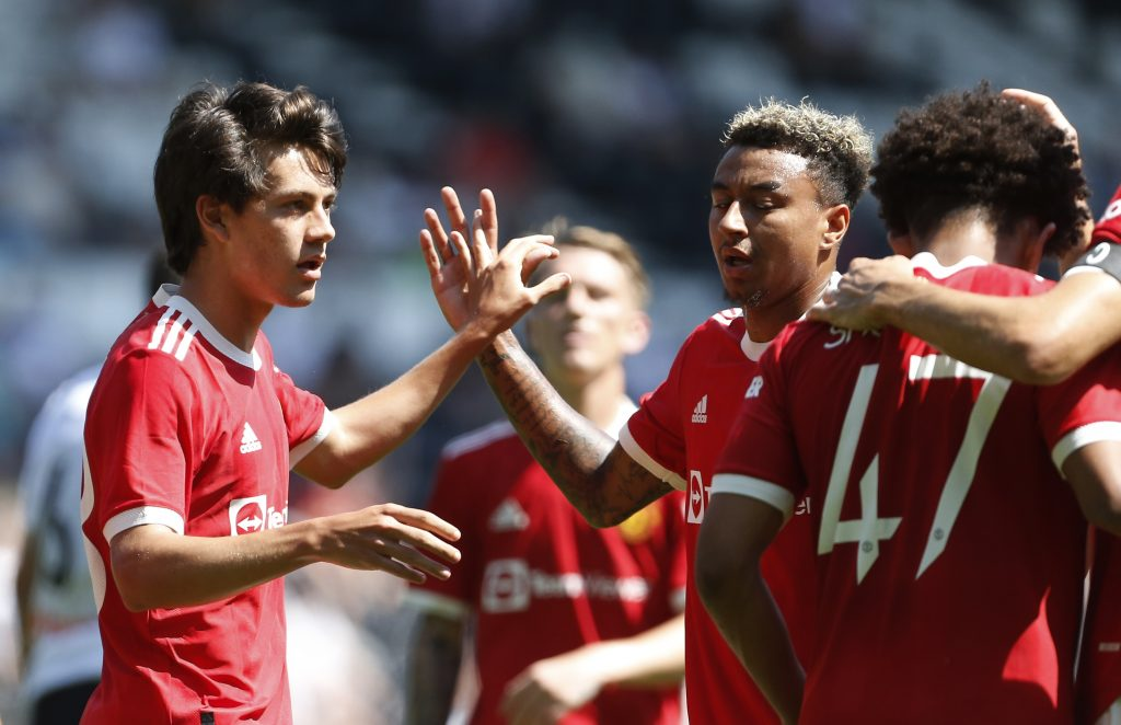 Manchester United's Facundo Pellistri celebrates with Jesse Lingard and teammates after scoring their second goal.