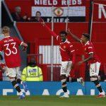 Manchester United's Anthony Elanga celebrates scoring their first goal with Jesse Lingard.