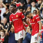 Manchester United's Bruno Fernandes celebrates scoring their first goal with Paul Pogba.