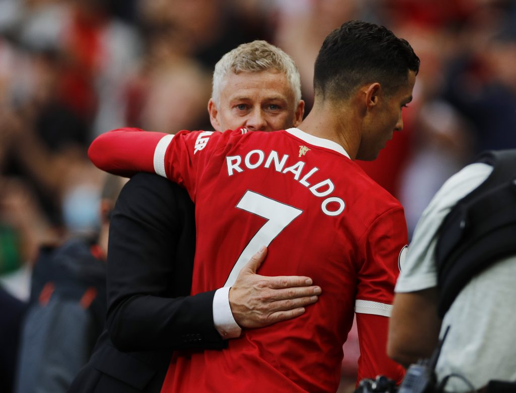Manchester United's Cristiano Ronaldo and manager Ole Gunnar Solskjaer celebrate after the match.