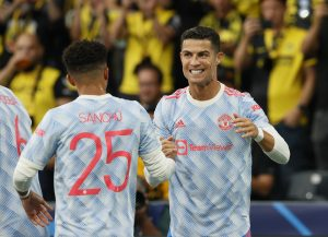 Manchester United's Cristiano Ronaldo celebrates scoring their first goal with Jadon Sancho.