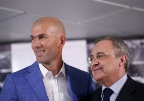 Zinedine Zidane (L) and Real Madrid's President Florentino Perez pose for the media.
