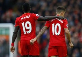 Philippe Coutinho celebrates scoring their second goal with Sadio Mane.