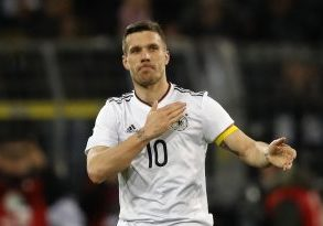 Germany's Lukas Podolski acknowledges the crowd.