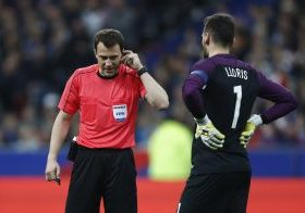 France's Hugo Lloris talks to referee Felix Zwayer.